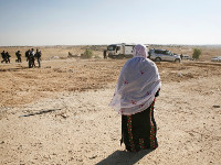 Al-Arakib: A Bedouin woman awaits news of her arrested son, 14-year-old Fayez Abumaegham al-Turi.